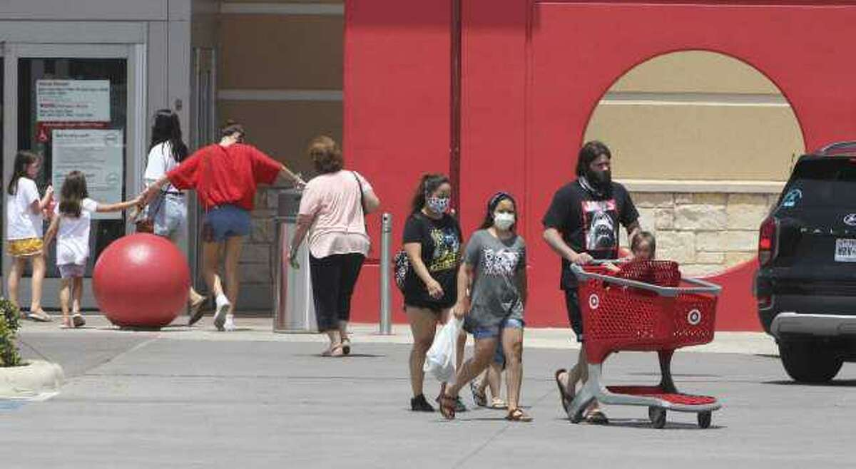 Shoppers come and go from a Target in New Braunfels in July. Target reported a huge jump in curbside pickups of orders.