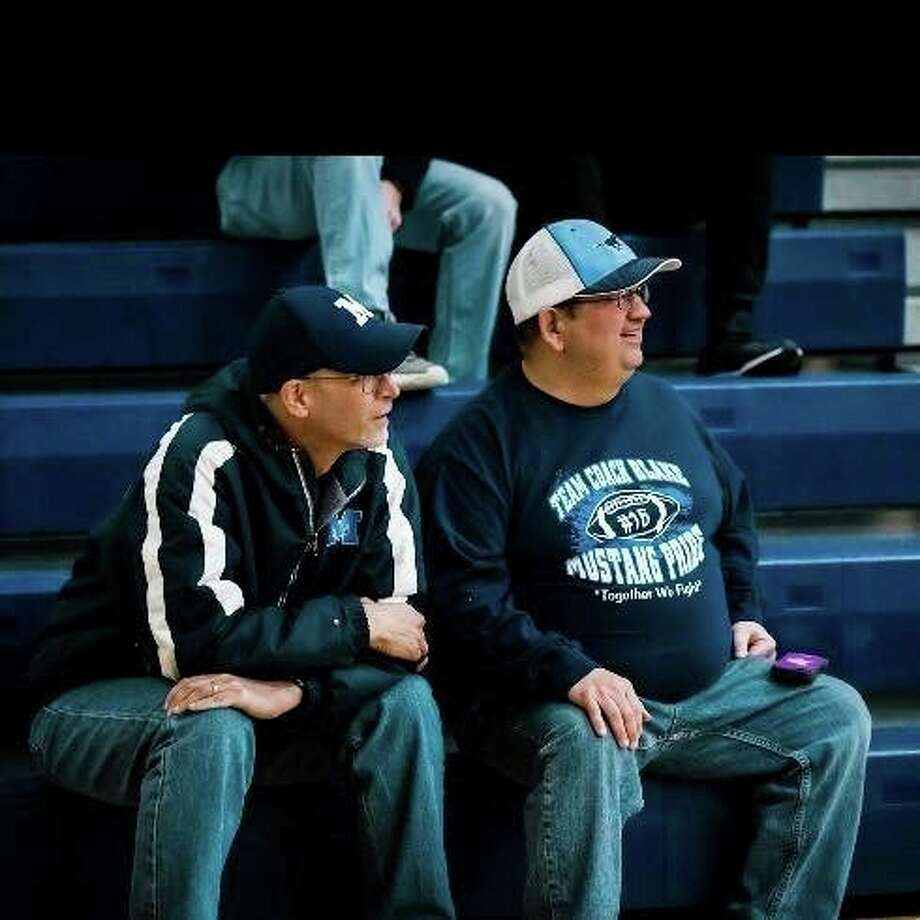 Aaron Blake, left, is shown watching a Meridian sporting event with his good friend, Mark Novak. (Photo provided/Mark Novak)
