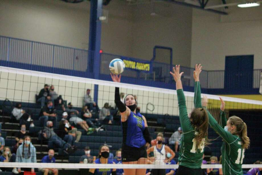 Morley Stanwood's Brooke Brauher goes up for the kill against West Michigan Christian on Friday. (Pioneer photo/John Raffel)
