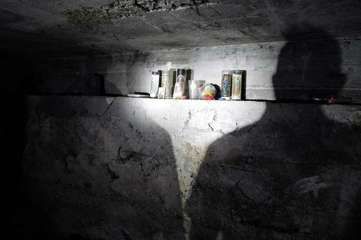 Members of Mexico's National Guard find a makeshift altar in the sewage and drainage system that connects Nogales, Mexico, with Nogales, Ariz.
