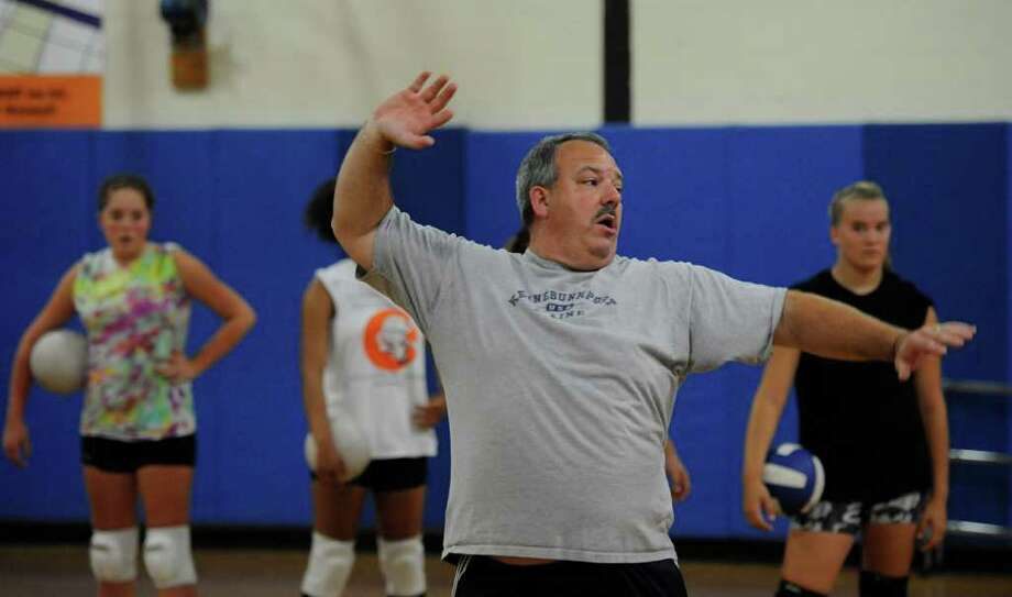 Coach Bob Wheeler runs girls'  volleyball practice at  Ichabod Crane High School in Valatie.  (Skip Dickstein/Times Union) Photo: Skip Dickstein