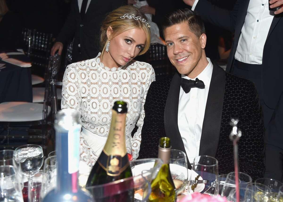 Business women Paris Hilton (L) and TV personality/real estate broker Fredrik Eklund attend amfAR's Inspiration Gala at Milk Studios on October 27, 2016 in Hollywood, California.
