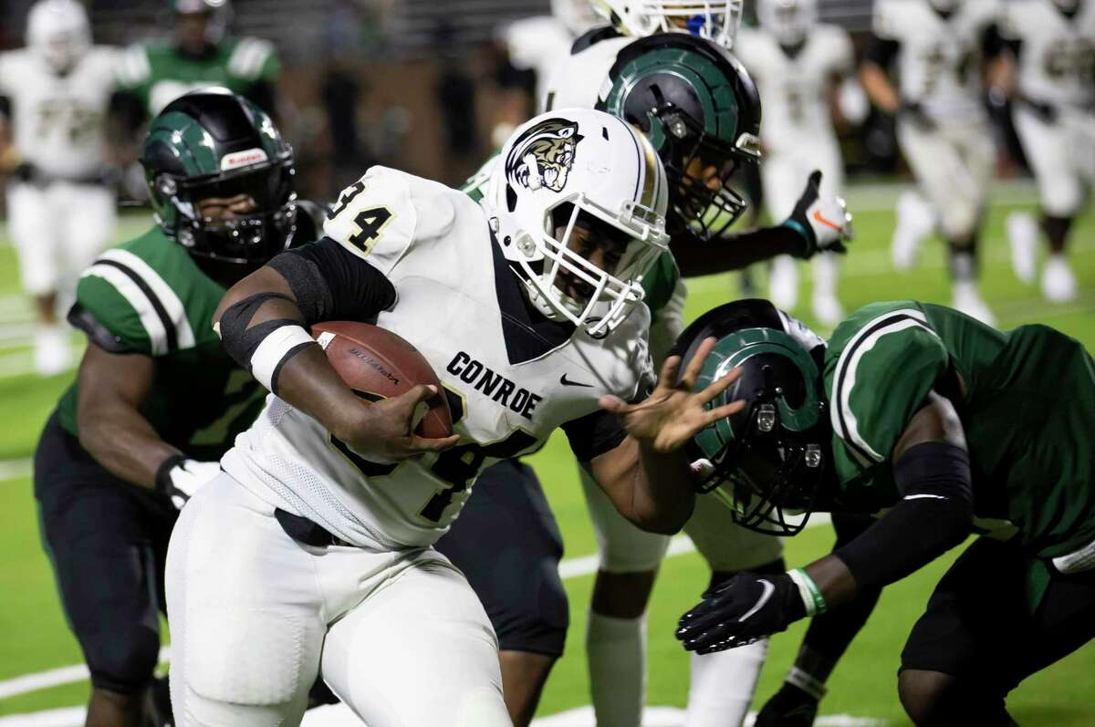 Conroe running back Jordan O'Neal (34) gets tackled by Mayde Creek linebacker Everett Haven Jr (7) during the fourth quarter of a non-district football game at Rhodes Stadium in Katy, Friday, Sept. 25, 2020.