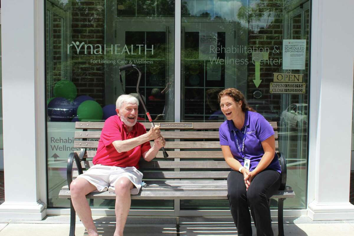 """Bill Bagley of Ridgefield enjoys a laugh with RVNAhealth physical therapist Casey Sarmiere following treatment. Ninety-seven percent of RVNAhealth Rehabilitation & Wellness Center patients rate their PT's understanding of their condition and goals as """"excellent."""""""