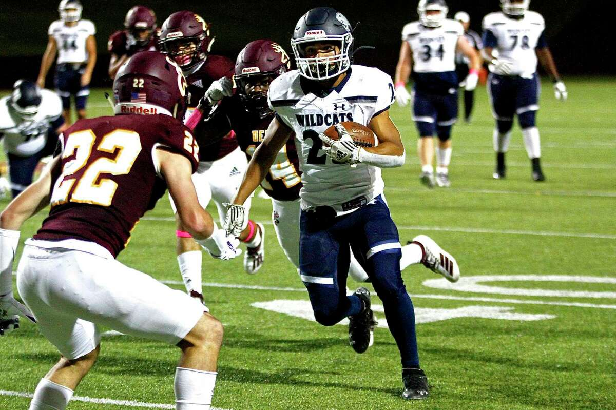 Tomball Memorial's Richard Rodriguez tries rushing past a defender in the Wildcats 69-35 win over Deer Park in a non-district game Friday, Oct. 9, at Abshier Stadium.
