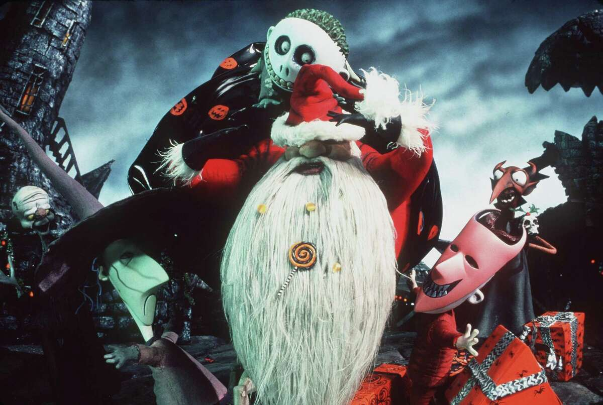 """Lock, right, Shock, left, and Barrel, center, return triumphantly to Halloweentown with """"Sandy Claws"""" in order that Jack Skellington can take his place in Touchstone Pictures animated film, """"Tim Burton's A Nightmare Before Christmas. (Joel Fletcher/Online USA/Hulton Archive/Getty Images/TNS)"""