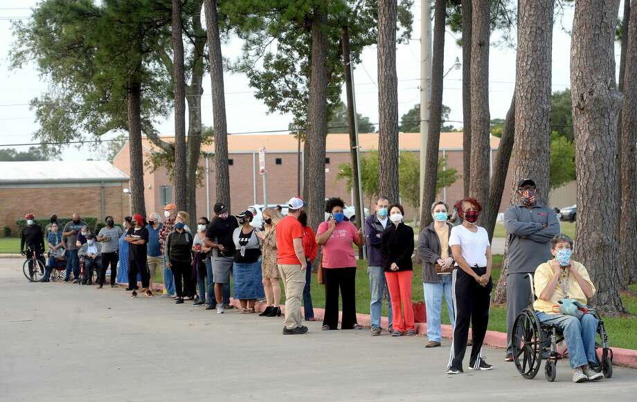A long line stretched along the drive at Rogers Park, extending onto Gladys Avenue, before polls opened at 8 a.m. for the first day of early voting in Texas. Photo taken Tuesday, October 13, 2020 Kim Brent/The Enterprise Photo: Kim Brent/The Enterprise