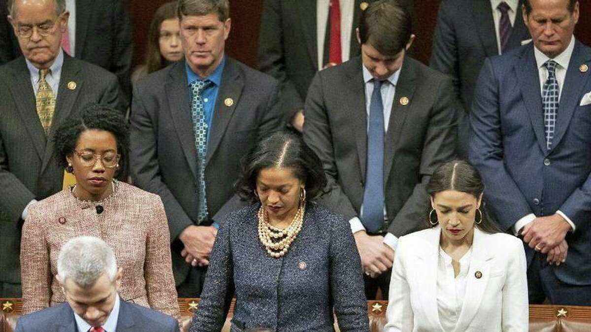 U.S. Rep. Jahana Hayes, D-Conn., (center) during an opening prayer as the House of Representatives assembles for the first day of the 116th Congress on Jan. 3, 2019.
