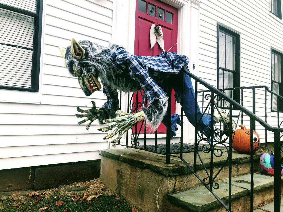 What's this, a New York pro football receiver dropping the ball? No, it's a ghoul scarecrow on Main Street in Wethersfield.