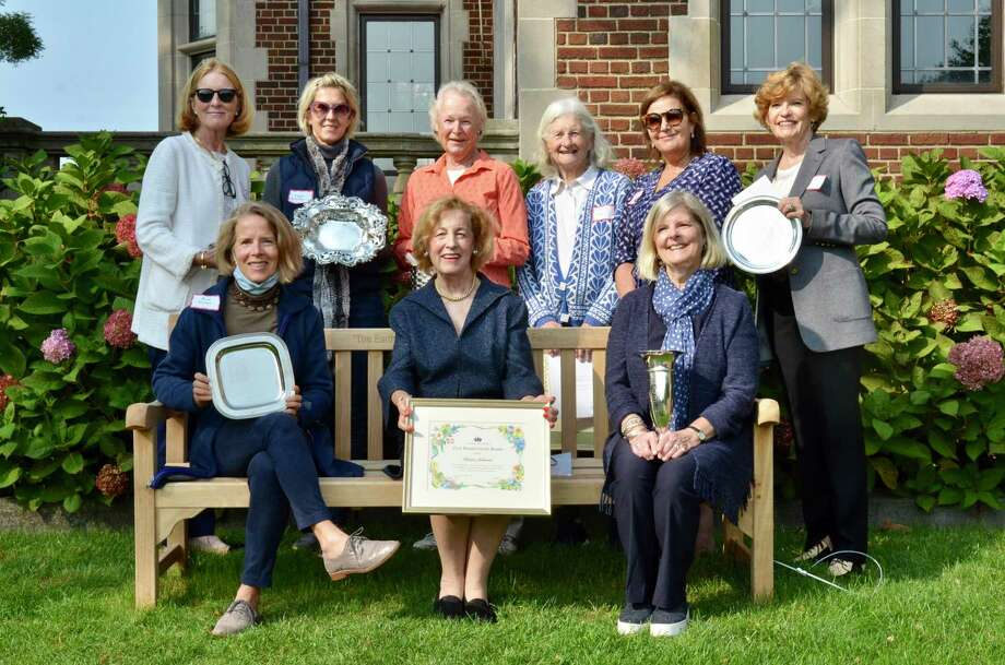 Accepting awards are New Canaan Garden Club members, (first row): Alice Wyman, Kristin Johnson and Catharine Sturgess; (second row): Jane Gamber, Kajsa Sheibley, Gill Foster, Fran O'Neil, Kate Burt, and Judy Neville. Missing are Anne MacKenzie, Maura Craig and Mary Tanzi. Photo: New Canaan Garden Club