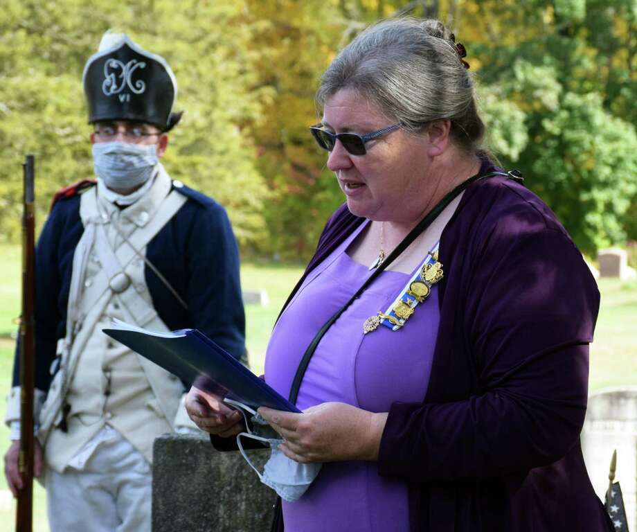 """Roger Sherman Chapter, DAR chaplain Marcella Martin offers the invocation at the start of the ceremony. The ceremony at Center Cemetery honored Pvt. Samuel Phillips and Pvt. Jeruel Phillips, two African-American soldiers from New Milford. """"To see the outpouring of community support,"""" said Denise Doring VanBuren, president general of the National Society Daughters of the American Revolution. """"This does my heart good.""""  Photo: Deborah Rose /Hearst Connecticut Media / Danbury News Times"""