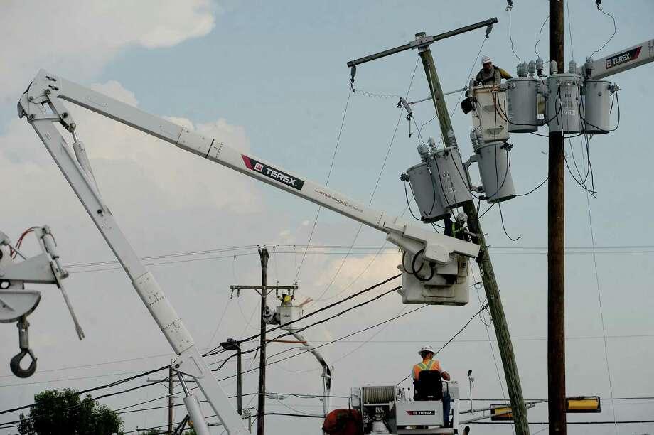 Linemen work on several utility poles along Phelan Boulevard in Beaumont Monday. Photo taken Monday, September 7, 2020 Kim Brent/The Enterprise Photo: Kim Brent / The Enterprise / BEN