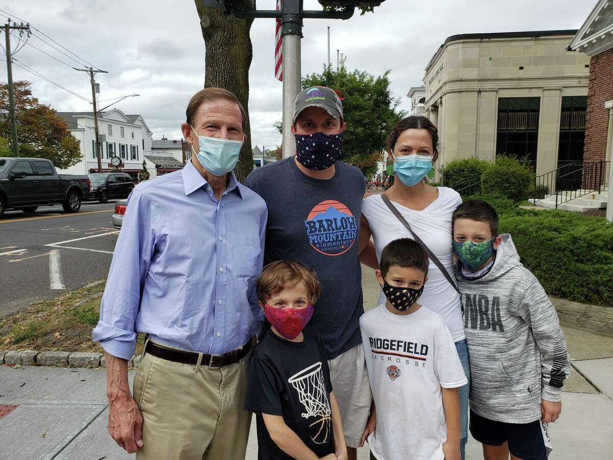 Senator Richard Blumenthal joined the Curran family on Main Street recently. From left, in back, Senator Blumenthal, Chris and Jessica Curran; in front, the boys Conner, William and Kyle