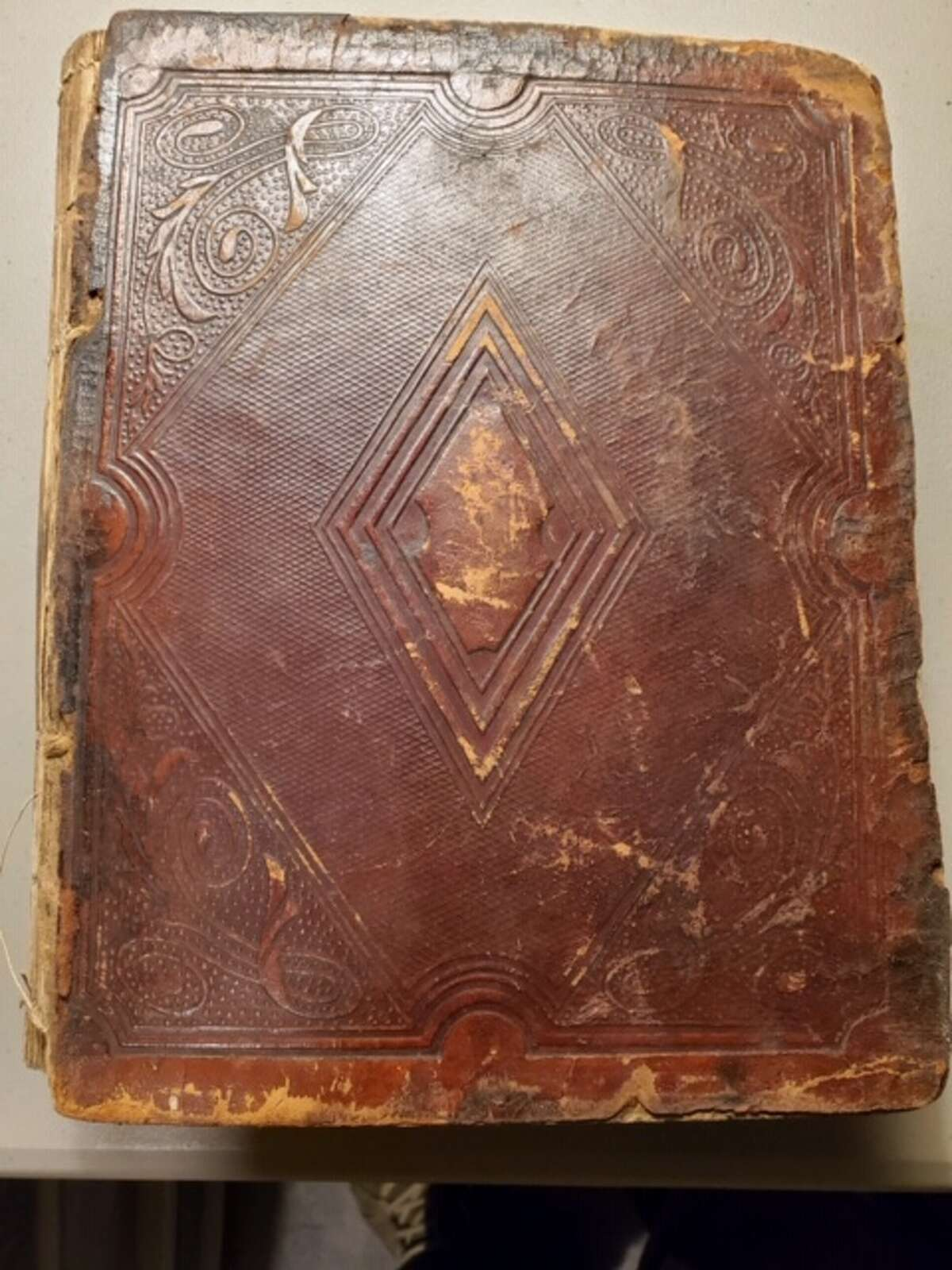 This 19th-century Corning family Bible was found in a Cleveland landfill nearly 50 years ago and preserved by a retired Navy chaplain who hopes to return it to the family or the Albany Institute