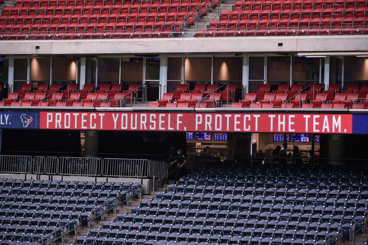 Signage encouraging fans to take precautions against COVID-19 are seen at NRG Stadium before an NFL football game between the Houston Texans and the Jacksonville Jaguars, Sunday, Oct. 11, 2020, in Houston. (AP Photo/Eric Christian Smith)