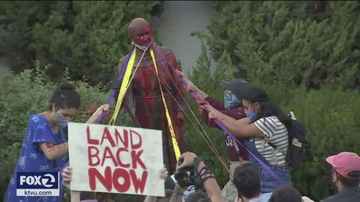 A gathering of indigenous people from the Miwok Tribe evolved and turned into activists who tore down a statue of Junipero Serra in San Rafael, Calif. on Oct. 13, 2020.