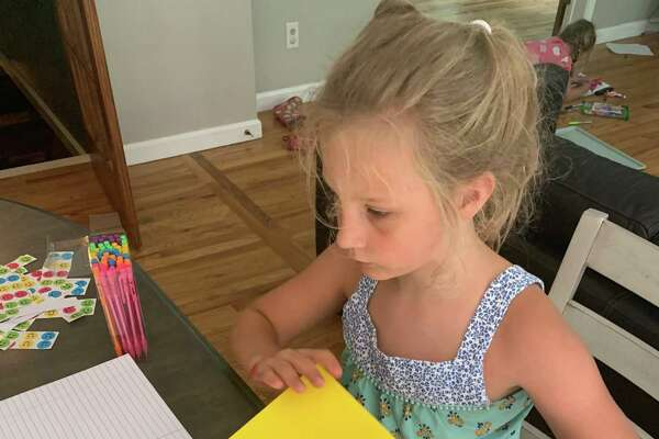 Stella Pozzuto, 7, of New Milford recently made 25 letter-writing kits for neighbors.