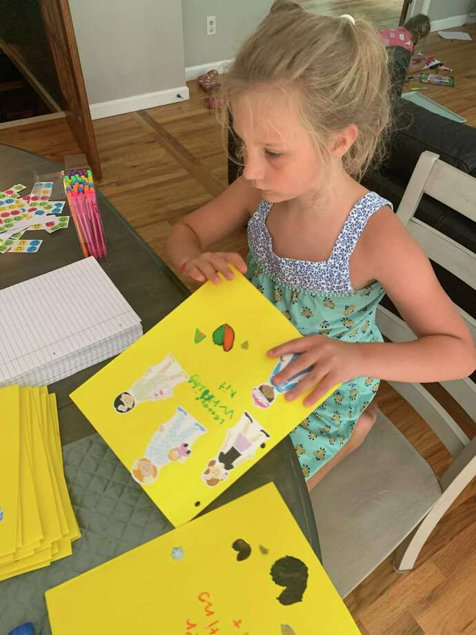 Stella Pozzuto, 7, of New Milford recently made 25 letter-writing kits for neighbors. Photo: Courtesy Of The Pozzutos / Danbury News Times Contributed