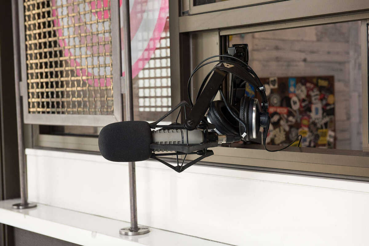 A mic outside of a small sliding window keeps both interviewer and interviewee safe.