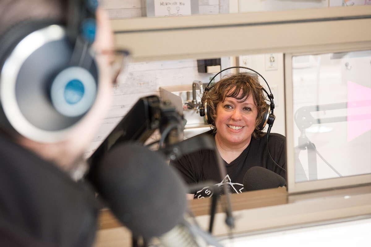 Amanda Guest tests the new mic setup through a sliding window.