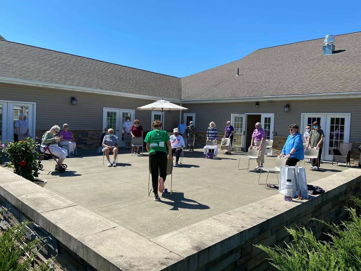 An outdoor exercise class at the Summit at Eastwyck Senior Independent Living Community. Local older adult living communities have seen an influx of residents, despite the pandemic.