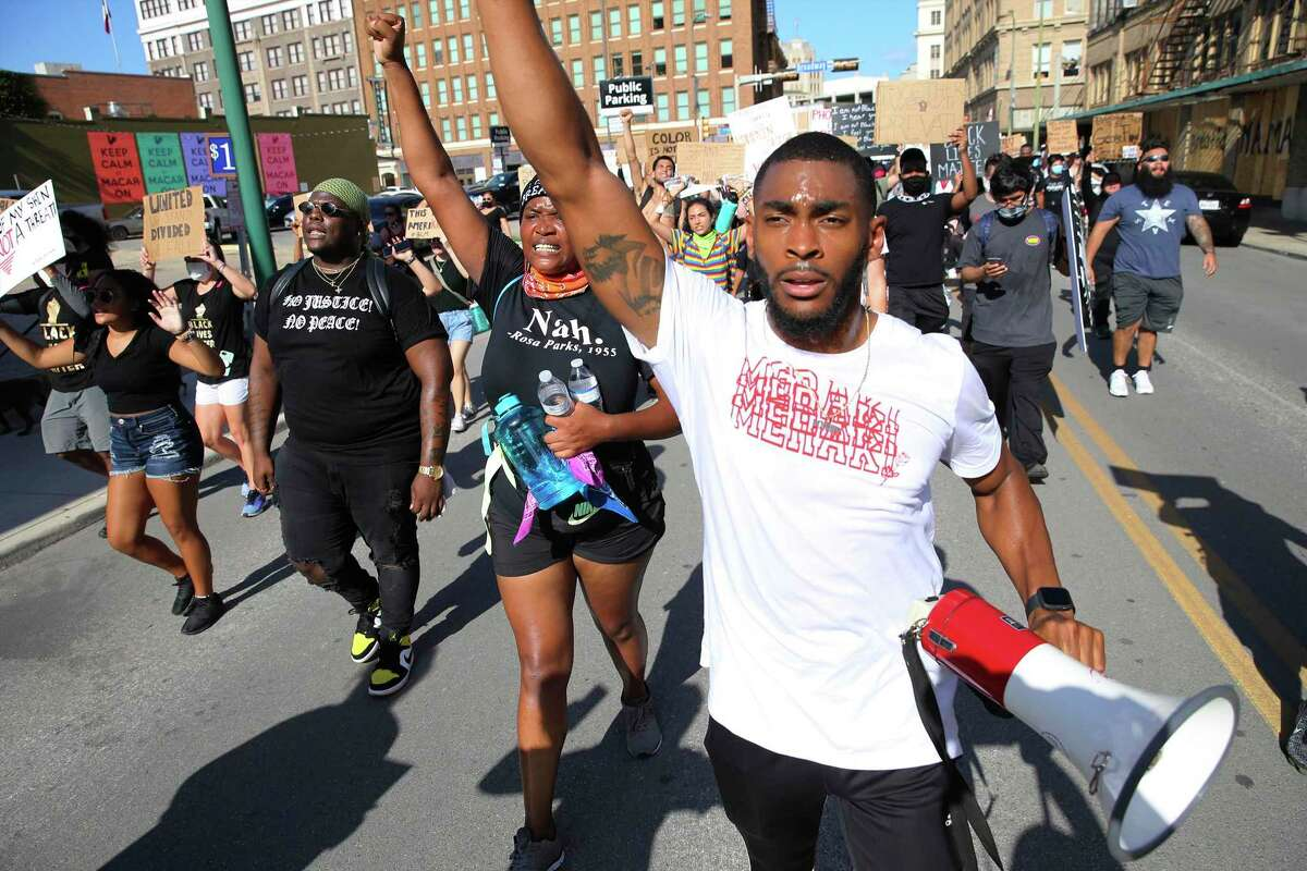 Trevon Taylor (from right), Jourdyn Parks and Tristdon Mays help lead a march by protestors from Bexar County Courthouse back to City of San Antonio Public Safety Headquarters on Friday, June 5, 2020. The death of African-American George Floyd at the hands of Minneapolis police last week has sparked national outrage and protests around racial inequality and police violence against people of color. San Antonio has had its share of protests demanding changes to policing policies and systemic racism.