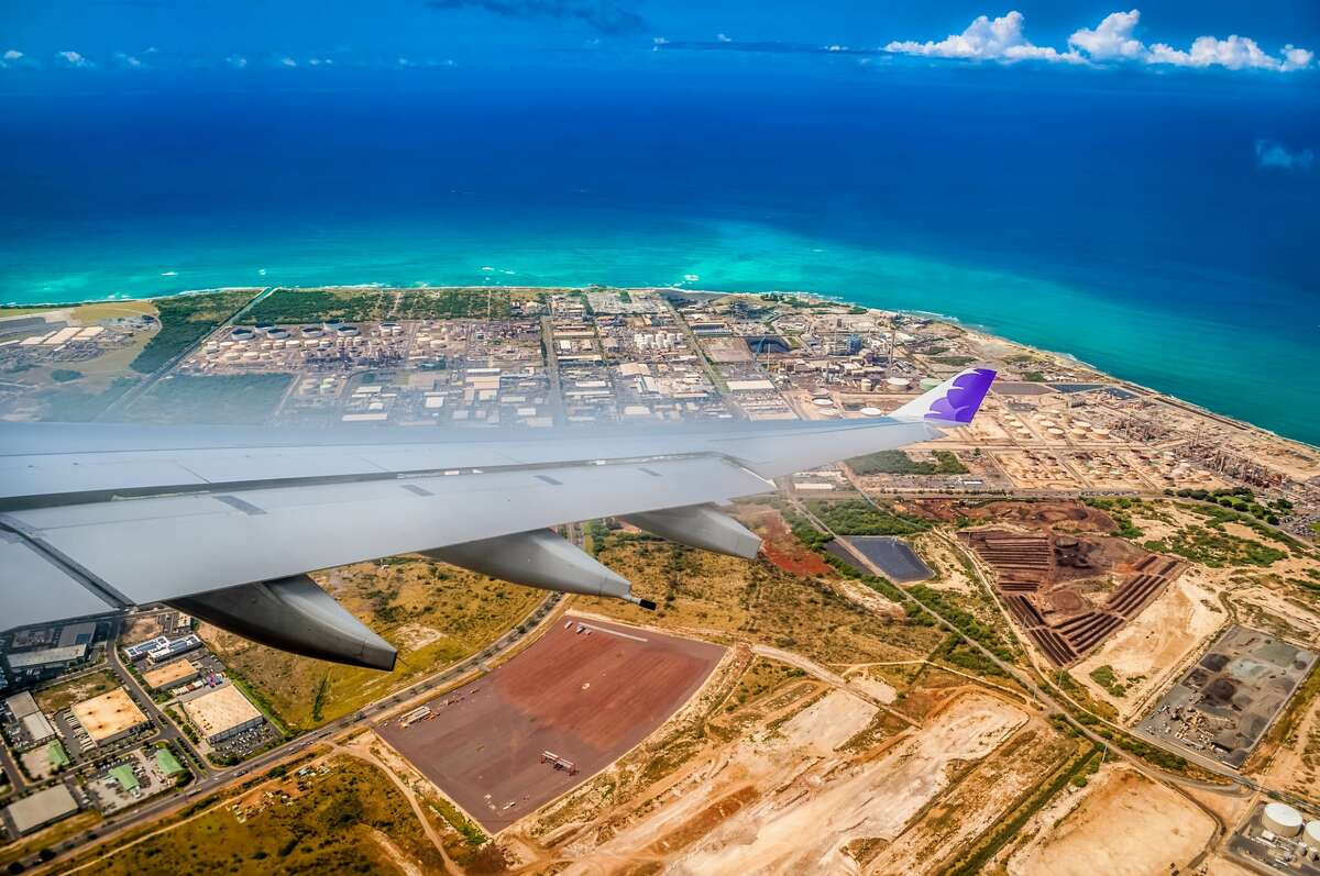 A Hawaiian Airlines jet on approach to Honolulu International Airport. On Oct. 15 2020, Hawaii re-opens to tourists who test negative for COVID-19