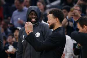 Stephen Curry #30 of the Golden State Warriors looks on with teammate Draymond Green #23 before the game against the Miami Heat at Chase Center on February 10, 2020 in San Francisco, California. (Photo by Lachlan Cunningham/Getty Images)