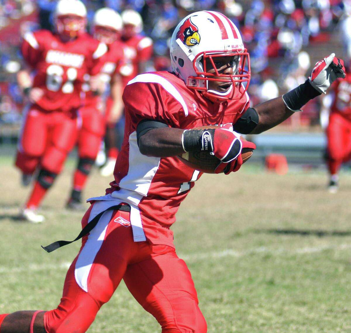 Bellaire wide receiver Derwyn Lauderdale gains extra yardage after catching a pass in the district game against Lamar on Oct. 31, 2009. Lauderdale, who became a coach at Travis High School, was fatally shot Oct. 11, 2020 at a Rosenberg sports complex.