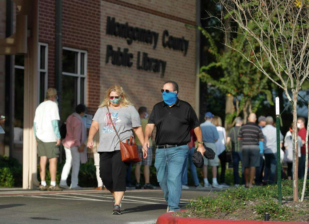 The line for early voting wraps around the Montgomery County Public Library building on the first day of Early Voting, Tuesday, Oct. 13, 2020, in The Woodlands.