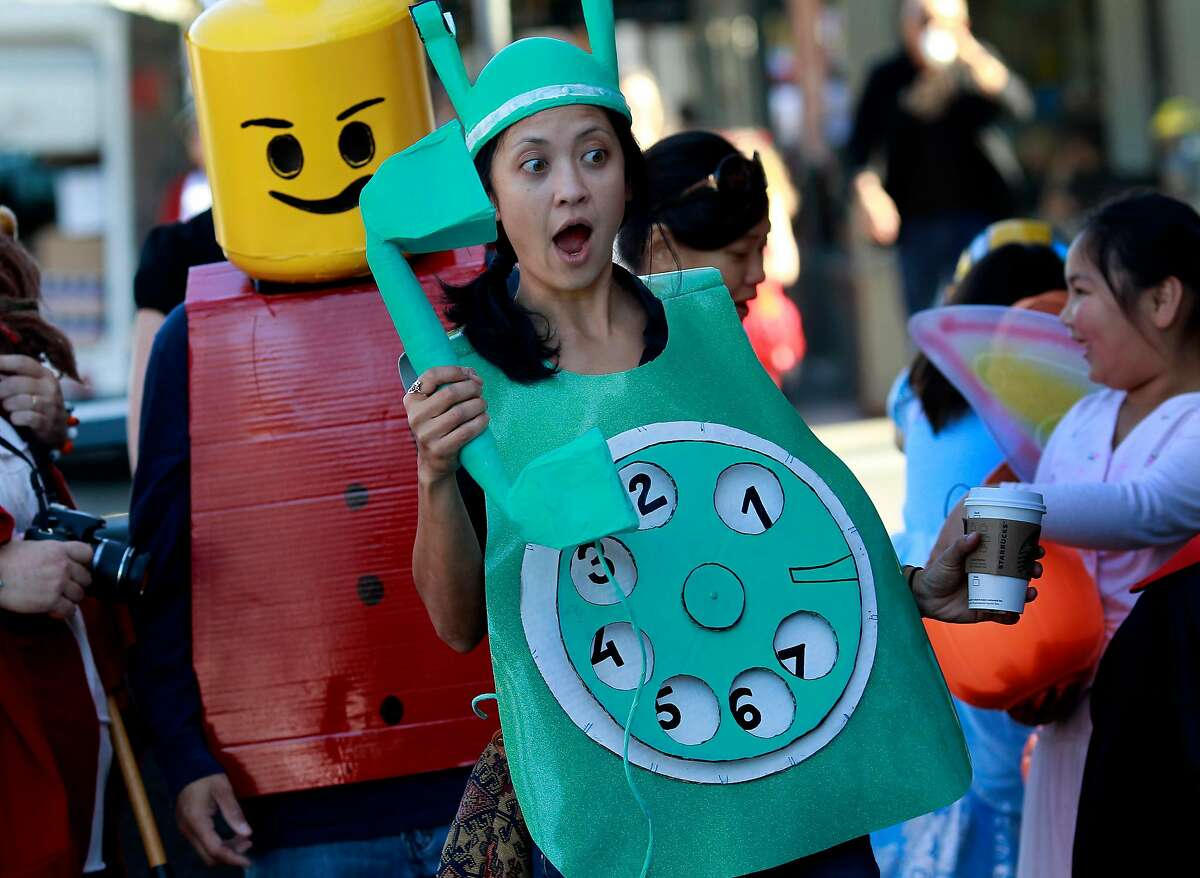 Sherman Elementary School art teacher Marissa Kunz dressed up as an old-fashioned rotary phone on Halloween 2011. This year, large events are not recommended because of the coronavirus pandemic.