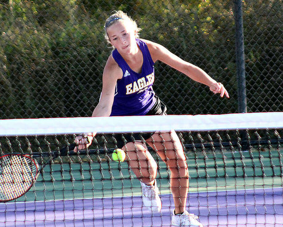 Civic Memorial's Allie Lively reach to make a return in her singles match against Greenville's Paige Mathias Monday at the new CM tennis courts. Lively won 6-1, 6-2. Photo: Pete Hayes | The Telegraph