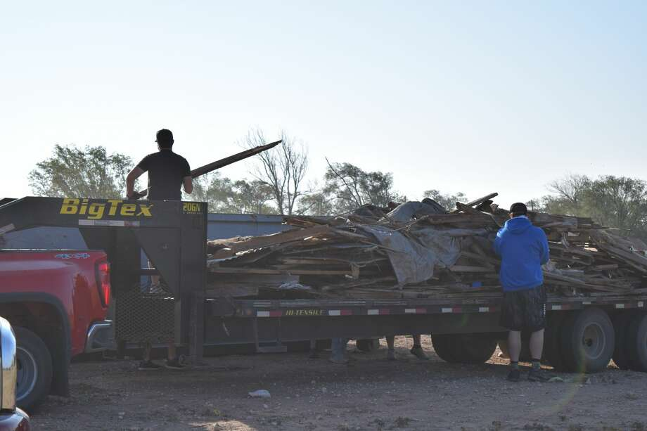 A group from Wayland Baptist University  assist with community clean-up in Seth Ward. Trash has been an ongoing problem in Seth Ward and longtime resident Diane Martinez is leading a charge to address it. Photo: Ellysa Harris/Plainview Herald