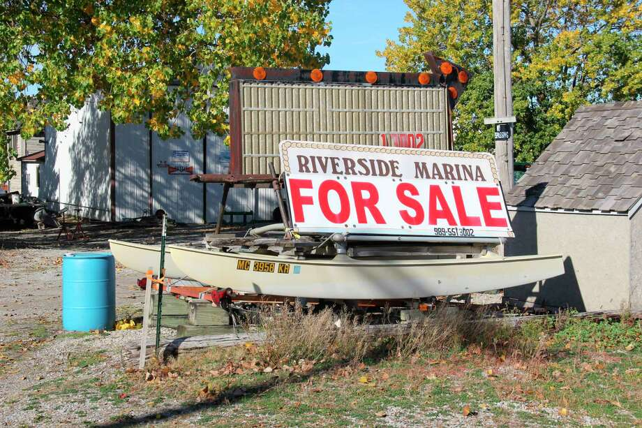 A sign in Caseville showing the Riverside Marina being for sale. The city has announced it acquired the property and will redevelop it in the coming year. (Robert Creenan/Huron Daily Tribune)
