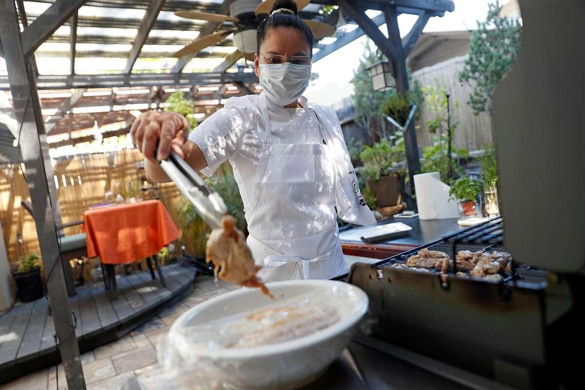 Home-kitchen entrepreneur Cheska Kistner grills in her backyard at her home in Benicia.