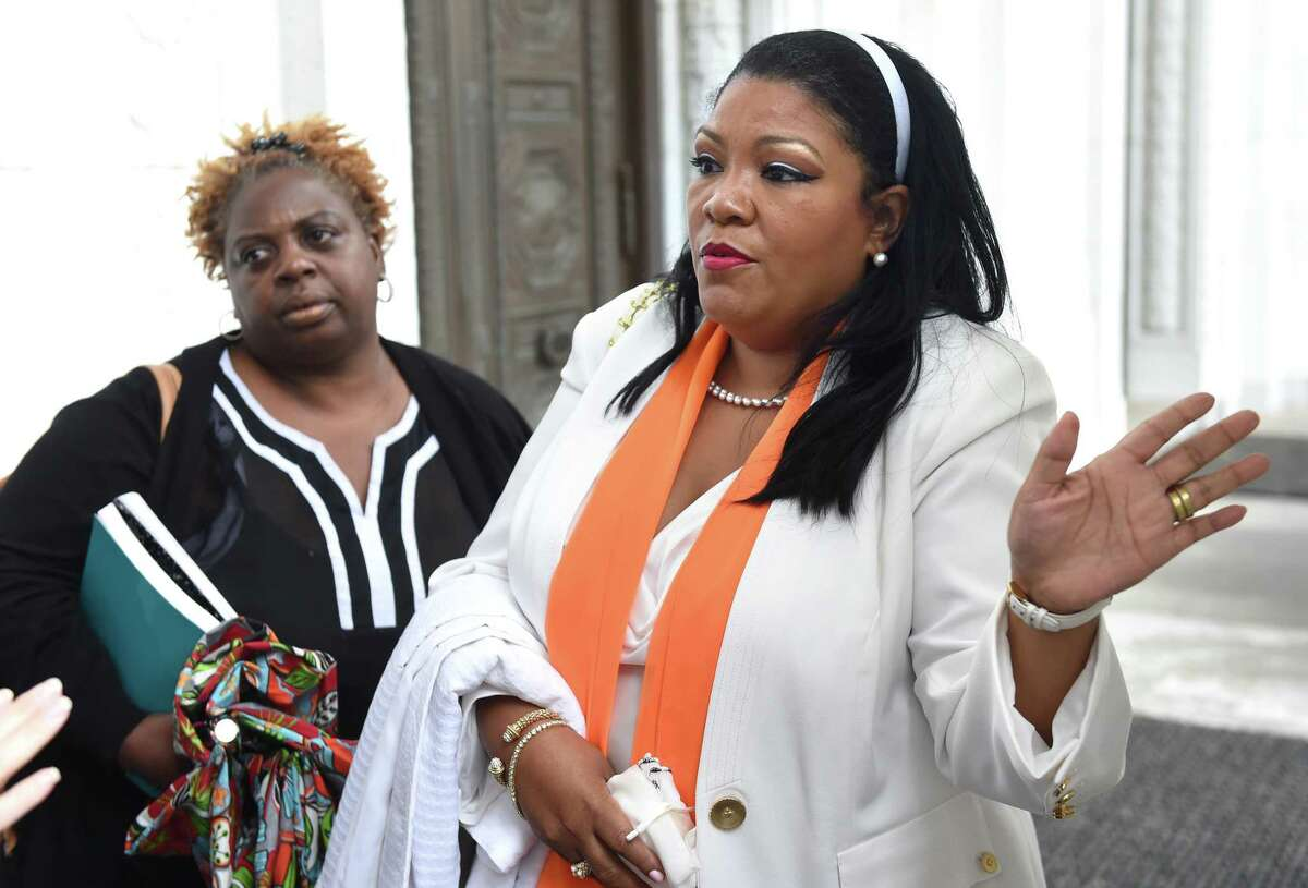 Cherlyn Poindexter, former union president of Local 3144, listens to Nichole Jefferson, former executive director of the Commission on Equal Opportunities, speak with attorneys outside of the Connecticut Supreme Court in Hartford on October 13, 2020.