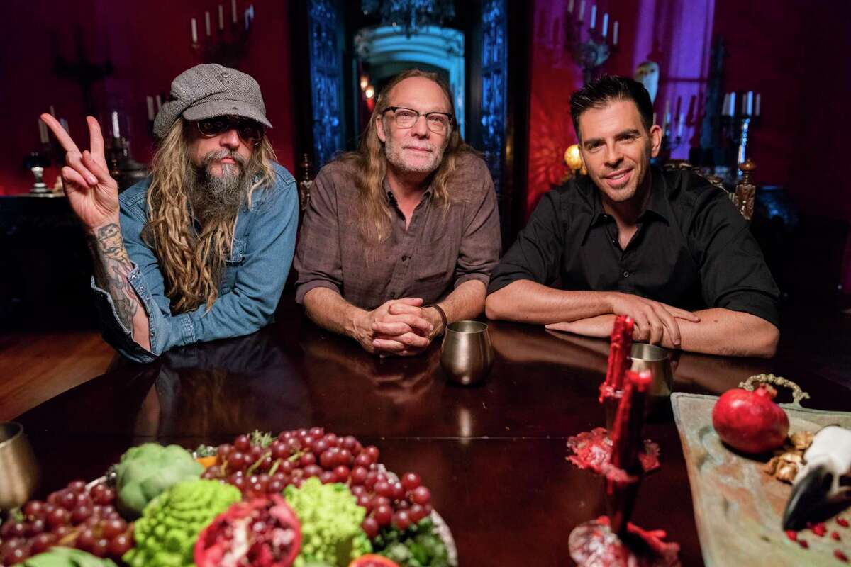 Eli Roth (left) chats about zombie disembowelment with Rob Zombie (right) and Greg Nicotero, executive director of