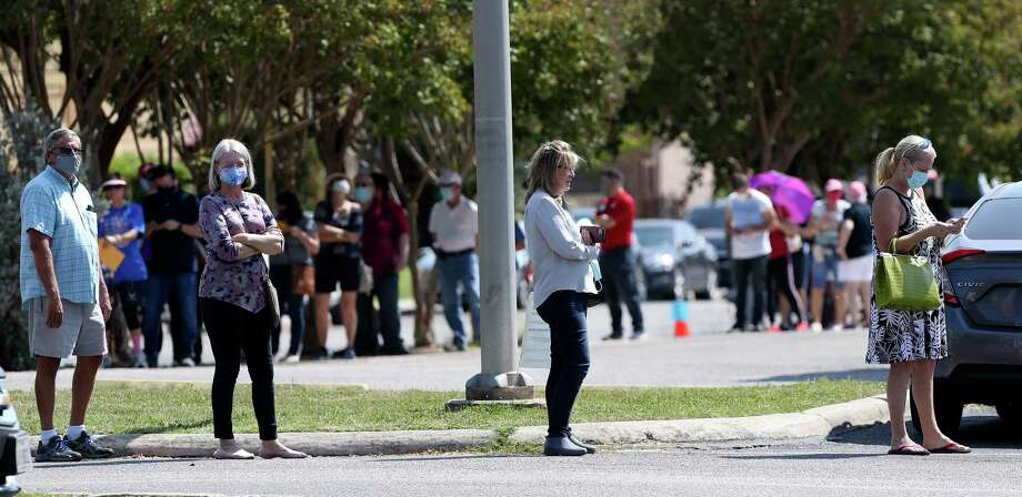 People social distance as they wait in line to vote at Brook Hollow Library on Oct. 13. If you haven't voted, yet, make it happen. Photo: Jerry Lara /San Antonio Express-News / **MANDATORY CREDIT FOR PHOTOG AND SAN ANTONIO EXPRESS-NEWS/NO SALES/MAGS OUT/TV   © 2019 San Antonio Express-News