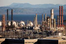 The Chevron Richmond Refinery is seen in Richmond, Calif. Tuesday, February 4, 2020. The Ninth Circuit Court of Appeals is scheduled Wednesday, February 5 to hear arguments from three counties and five cities, including San Francisco and Oakland, on why their groundbreaking climate lawsuits should proceed in state court rather than federal court.