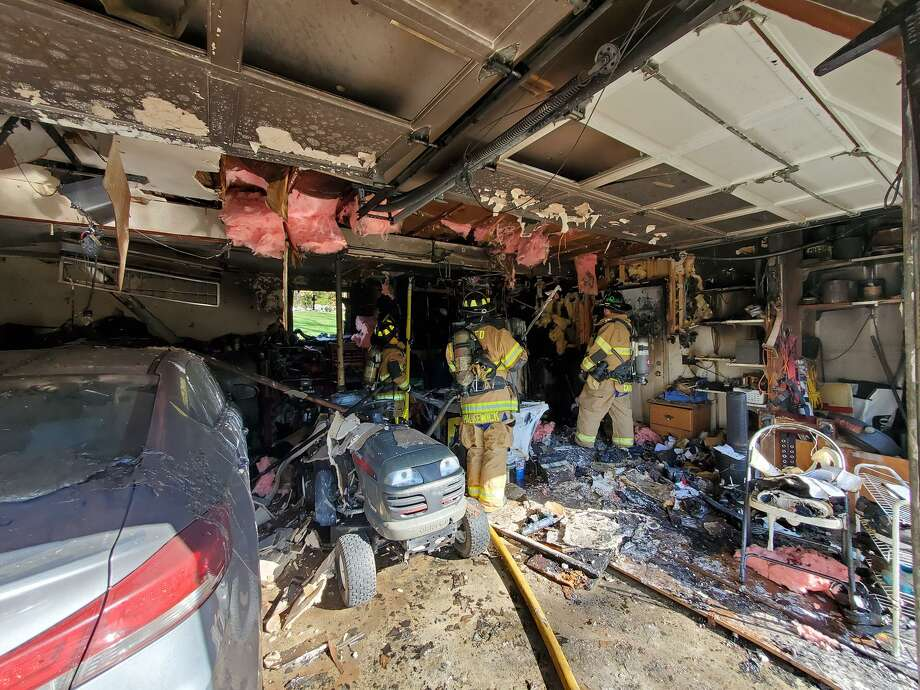 Firefighters respond to a fire in a garage on Frisbie Street in New Fairfeild, Conn., Oct. 9, 2020. Photo: New Fairfield Volunteer Fire Department