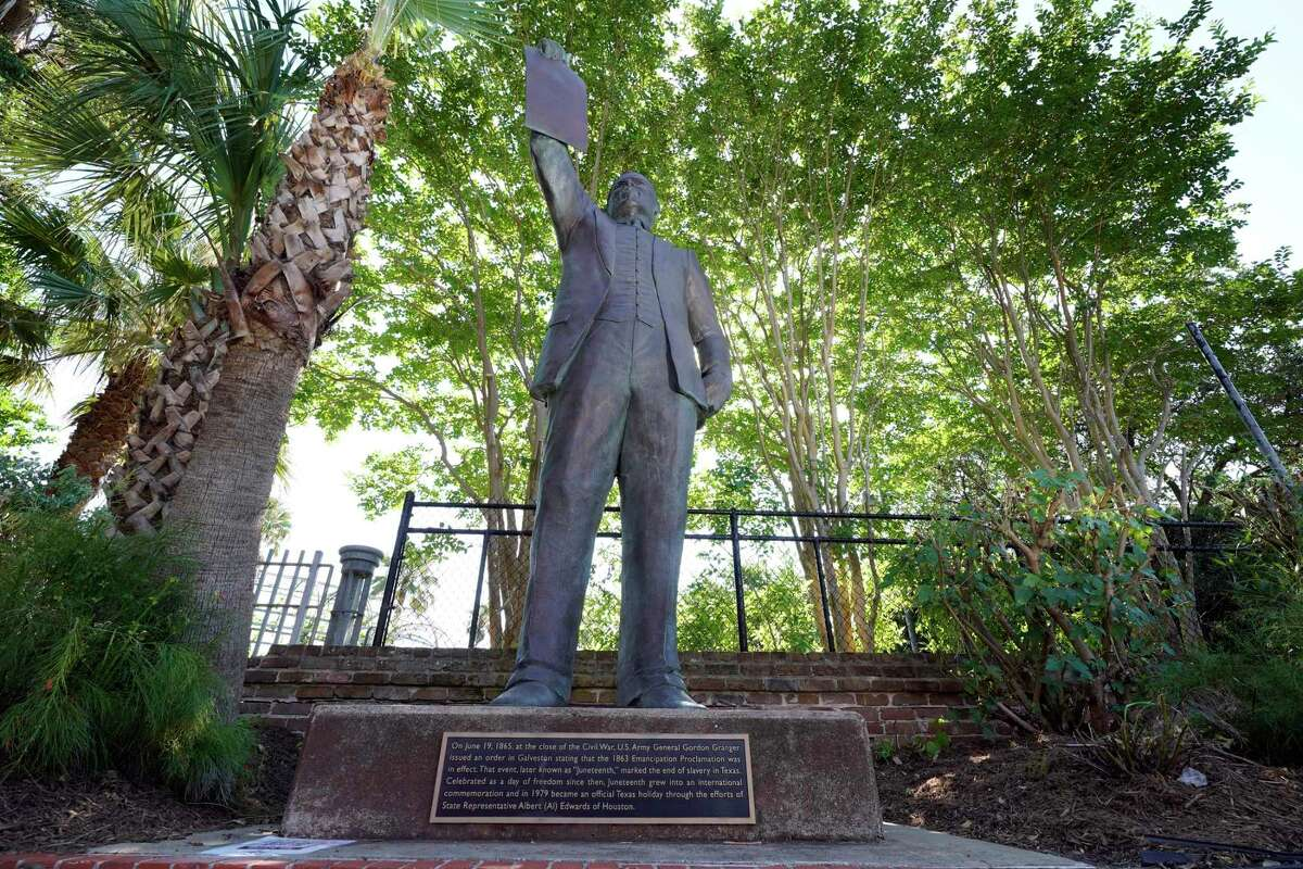 A statue in Galveston depicts a man holding the state law that made Juneteenth a holiday. As recently as 2010, textbooks in Texas left out slavery as a central cause of the Civil War.