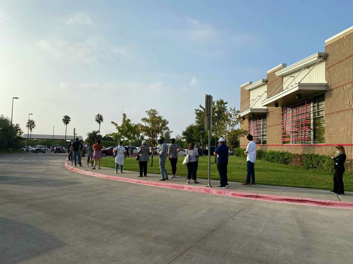 At 9 a.m. the line to vote at the fire station on Del Mar was wrapped around the building.