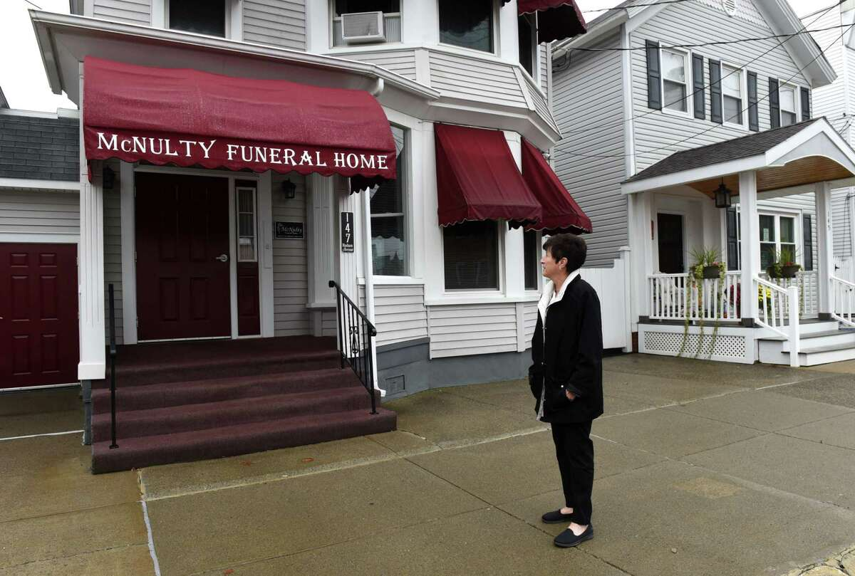 Ellen McNulty-Ryan is pictured outside her former family business, McNulty Funeral Home, on Tuesday, Oct. 13, 2020, in Green Island, N.Y. Ellen, who is also the mayor of Green Island, recently closed the funeral home in part due to the coronavirus pandemic. Jack McNulty opened the business in1945 after retuning from World War II. (Will Waldron/Times Union)