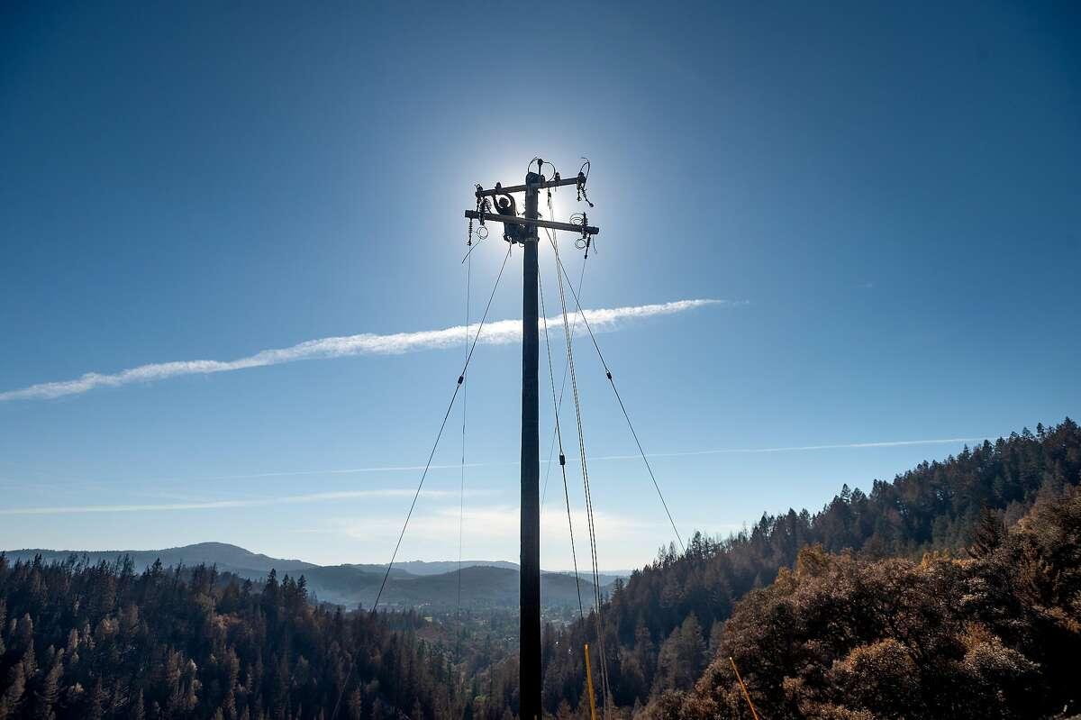 PG&E apprentice Oscar Rodulfo works to restore power along Los Alamos Road in Santa Rosa in October.