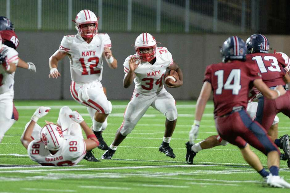Ron Hoff (34) of Katy carries the ball during the fourth quarter of a 6A Region III District 19 football game between the Katy Tigers and the Tompkins Falcons on Thursday, October 3, 2019 at Legacy Stadium, Katy, TX.