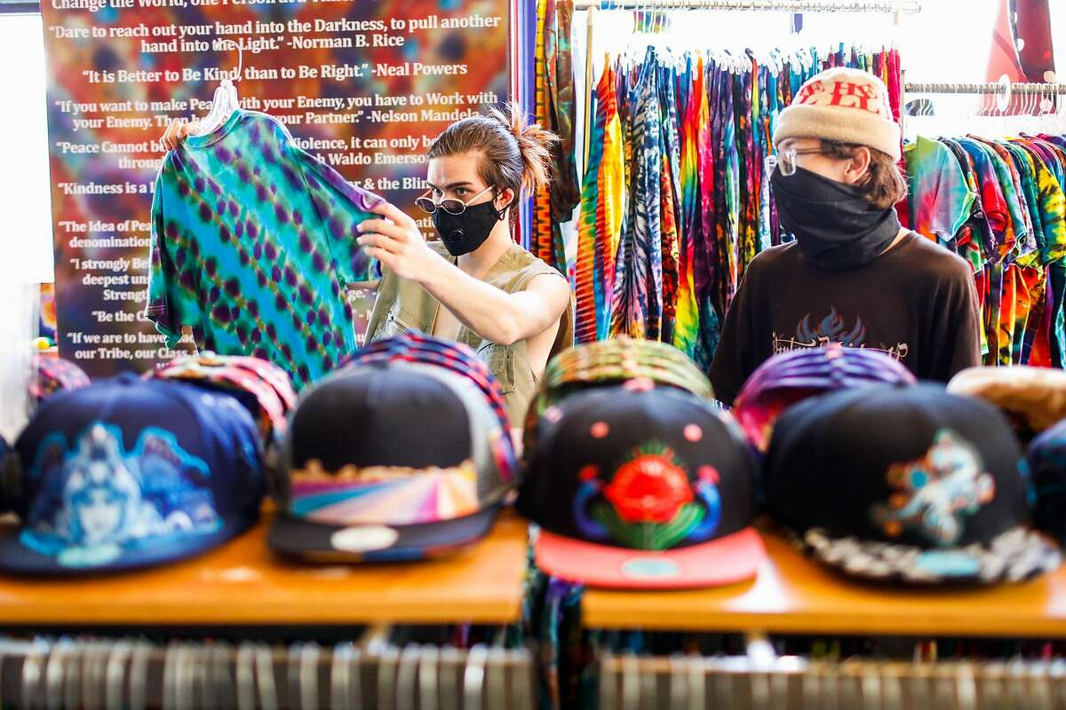 Cody Dalton (left) and Will Pamula shop at Love on Haight Street in San Francisco.