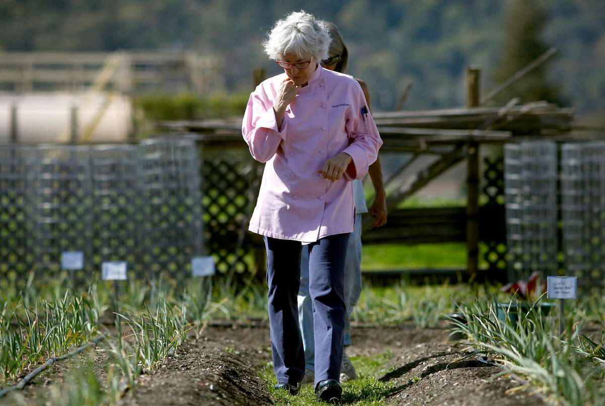 Cindy Pawlcyn walks through the garden on the property of her restaurant Mustard's Grill, which she opened in 1983.