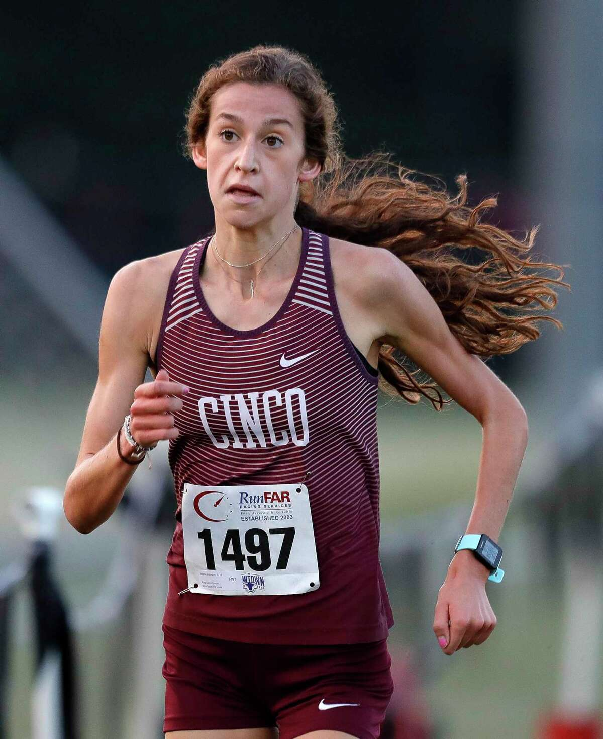 Cinco Ranch's Sophie Atkinson finished 1st overall at the Seven Lakes Invitational to help the Cougars' girls cross-country team to a championship.