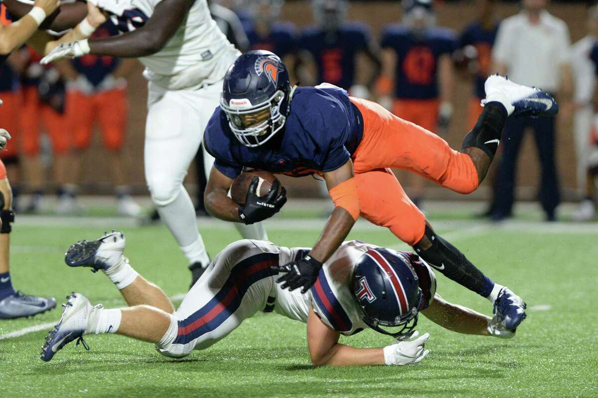 Milton Jones (27) of Seven Lakes is tackled by Jeremy Tas (34) of Tompkins during the third quarter of a 6A Region III District 19 football game between the Seven Lakes Spartans and the Tompkins Falcons on Friday, September 27, 2019 at Rhodes Stadium, Katy, TX.