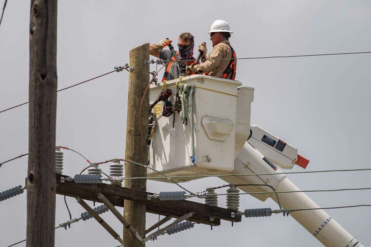 In spite of the heat advisory, electrical linemen are working countless hours all over Southeast Texas to get the power back on, like these men working near the Port Neches city limits along FM 366 on Tuesday afternoon. Photo made on September 1, 2020. Fran Ruchalski/The Enterprise